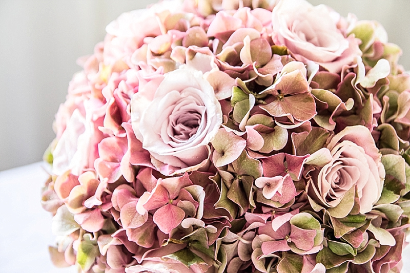 Photo of a bridal bouquet of pink and white flowers.